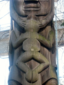 Detail of a frog symbol on a totem pole at the Vancouver Airport, B.C. (Credit: MCArnott)